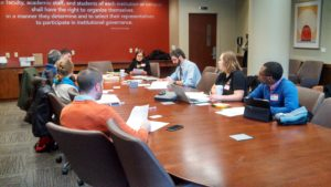 Community of Practice meeting around a table.