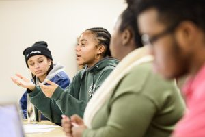 Students engaging in discussion at the Multicultural Student Center.